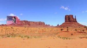 stock-footage-geronimo-native-american-flag-flies-at-monument-valley-arizona-landmark