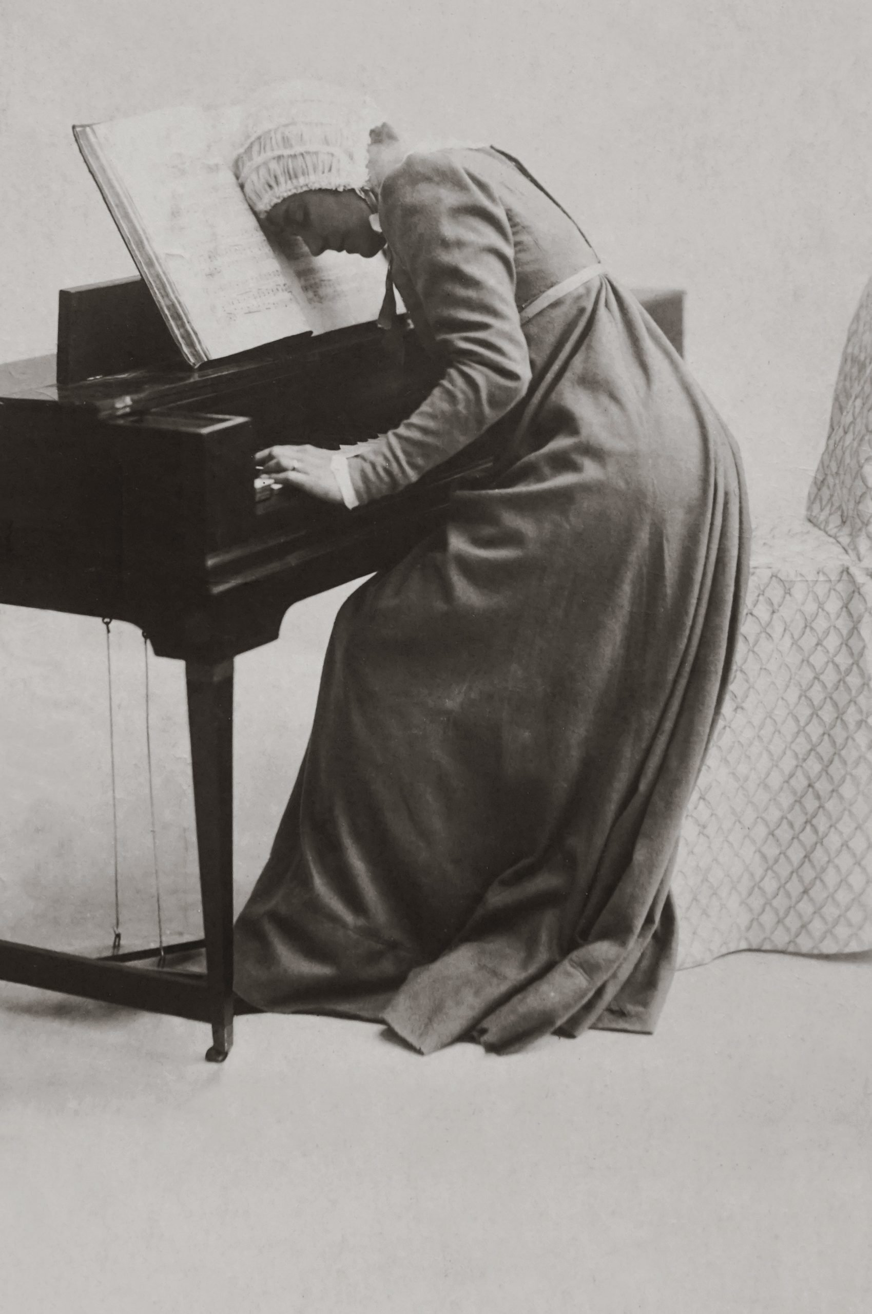 woman with music notes on old piano